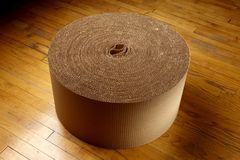 Roll of corrugated packing material Stock Images