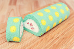 Roll cream cake with yellow dot pattern Royalty Free Stock Images
