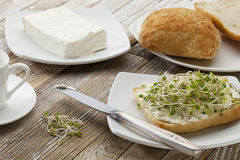 Roll with cream cheese and sprouts stock photography