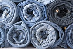 Roll denim jeans Stock Photo