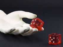 Roll of the dice. Photo of a hand rolling a pair of dice Royalty Free Stock Photo