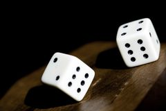 Roll the dice. Close up photo of a dice rolling on a backgammon Royalty Free Stock Photo