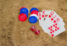 Roll the Dice Again. Poker party on the beach Royalty Free Stock Images