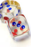 Roll The Dice, Throw The Dice. Off balance, vertical shot of dice in white background royalty free stock photography