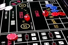 Roll the Dice2. Rolling the dice at a craps table stock image