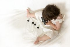 Roll the Dices. Little girl playing with dices, seen from above stock image