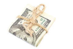 Roll of dollar banknotes on white background. Stock Photos