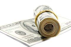 Roll of dollar bills. On the hundred dollar bill Royalty Free Stock Images