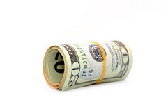 Roll of 20 dollar bills. On white background. Isolated on white royalty free stock photos
