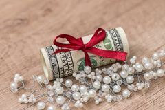 Roll of dollar on desk.  Stock Images