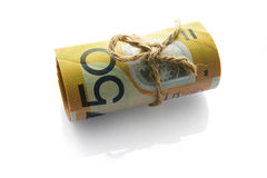Roll of Dollar Notes Tied with String Stock Photo