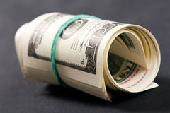 Roll of dollars Stock Images