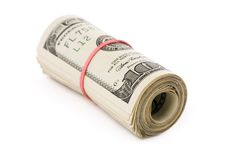 A roll of dollars. With white background royalty free stock images