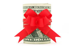 Roll of dollars. With red ribbon bow isolated Royalty Free Stock Photos