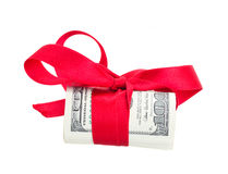 Roll of dollars with bow. Roll of dollars with red bow isolated on white background Stock Image