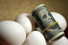 Roll of dollars with eggs Royalty Free Stock Photography
