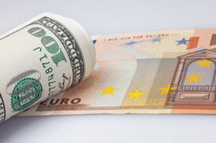 Roll dollars and euro Royalty Free Stock Photos