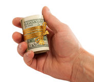 Roll of dollars in hand. Stock Image