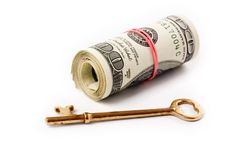 A roll of dollars and key. Concept of finance success Royalty Free Stock Photography