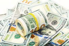 Roll of dollars on money background Royalty Free Stock Photography