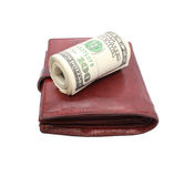 Roll of dollars on old leather purse Royalty Free Stock Image