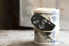 Roll of dollars. One roll from dollars and a tag with a dollar sign Stock Images