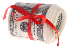 Roll dollars with red bow. Isolated Stock Images