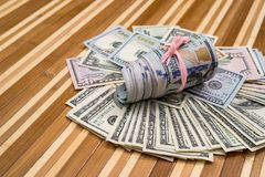 Roll of dollars. On wooden background Royalty Free Stock Photography