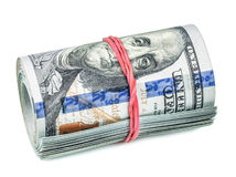 Roll of dollars with rubber band Royalty Free Stock Images