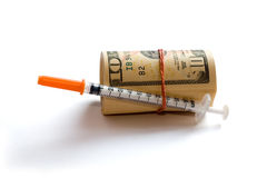 A roll of dollars with syringe Stock Photography