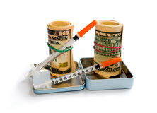 A roll of dollars with syringe Stock Images