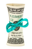 Roll of dollars wrapped by ribbon over white Stock Photo