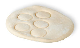 Roll dough with pressed through circles Stock Image
