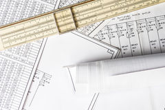 Roll of drawing and slide rule Royalty Free Stock Images