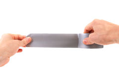 Roll of duct tape in hands. On white background Royalty Free Stock Photo