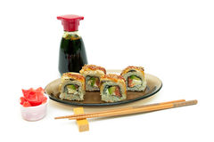 Roll with eel, salmon and avocado, ginger and soy sauce on white Royalty Free Stock Image