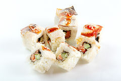 Roll with eel, salmon and cucumber Royalty Free Stock Image
