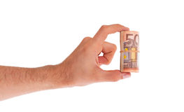 Roll of 50 euro bills in hand Royalty Free Stock Photo
