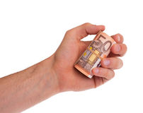 Roll of 50 euro bills in hand Royalty Free Stock Photos