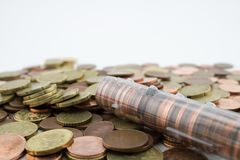 Roll with euro cent coins over more varied coins. Coins of little value. Savings stock image
