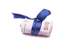 Roll of euro money and blue bow Royalty Free Stock Image