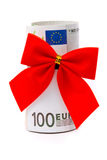 Roll of Euro money and red bow Royalty Free Stock Photos