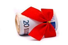 Roll of Euro money and red bow Royalty Free Stock Image