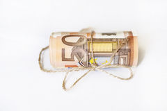 Roll of euro money and twine cord ribbon Stock Photo
