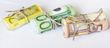 Roll of euro money and twine cord ribbon Stock Images