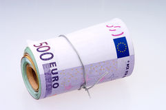 Roll of euros close-up on gray background. Stock Photos