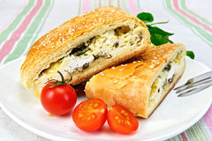 Roll filled with spinach and cheese in bowl on tablecloth Royalty Free Stock Photography