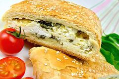 Roll filled with spinach and cheese on linen tablecloth Stock Photos