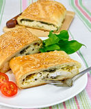 Roll filled with spinach and cheese on tablecloth Stock Images