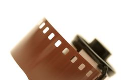 Roll of film. 35mm, an angled macro shot over white with very shallow depth of field Royalty Free Stock Photos